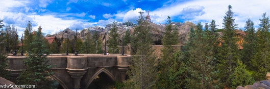 "This is a panoramic picture of The Enchanted Forest in New Fantasyland, Magic Kingdom in Walt Disney World. In the photo you can see Maurice's house ""Enchanted Tales with Belle"" to the left and the Beast's castle ""Be Our Guest Restaurant"" in the middle with the bridge leading up to the restaurant."