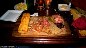 Assorted Cured Meats and Sausages served with Cornichons, Pickled Onions, and Toasted Baguette