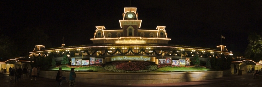 Panoramic Photo of the Disney World Train Station at Night.